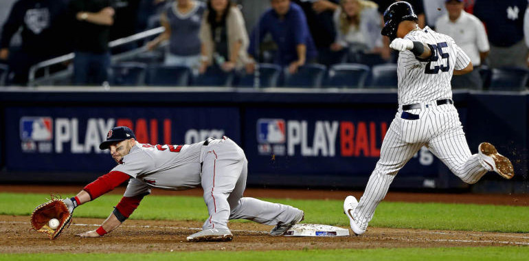 Oct 9, 2018; Bronx, NY, USA; Boston Red Sox left fielder Steve Pearce (25) reaches for the ball to get the last out on New York Yankees second baseman Gleyber Torres (25) in game four of the 2018 ALDS playoff baseball series at Yankee Stadium. Mandatory Credit: Noah K. Murray-USA TODAY Sports