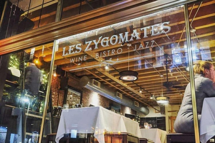 Looking into the restaurant window of Les Zygomates